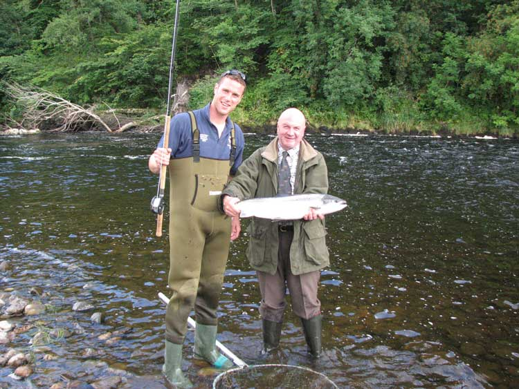 James with Sam Bremner proudly display a beautiful fresh hen salmon (10lbs approx ) She was returned unharmed to the river